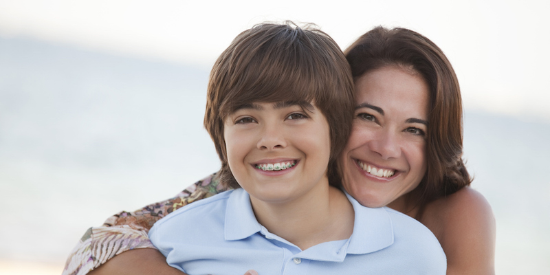 mother and son both showing the results of their orthodontic treatment