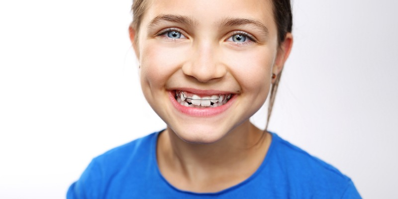 Smiling young girl who is happy with her early orthodontic treatment